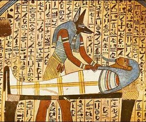 Anubis Concluding Mummification of Dead Man