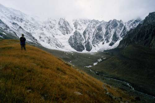 This is a partial view of the Kolka Glacier (center). (The photograph taken by Sergei Chernomorets on Sept. 22, 2001.) Source:jsc.nasa.gov
